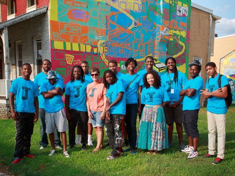 journey2home artists, participants and staff in front of Home Safe mural by Ernel Martinez and Shira Walinsky. Photo by Steve Weinik.