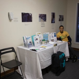 Rodney from PEC with the resources table, Photo by Weiyi (Dawn) Cai